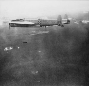 Avro Lincoln Bomber A73-33 of No. 1 Squadron RAAF on a bombing mission over the Malayan jungle. Two 500 pound bombs can be seen falling from the aircraft.